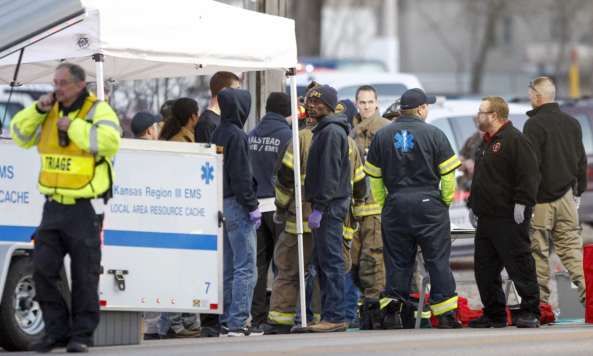 EMS workers gather a staging area by Excel Industries in Hesston, Kansas, Thursday, Feb 25, 2016.—AP