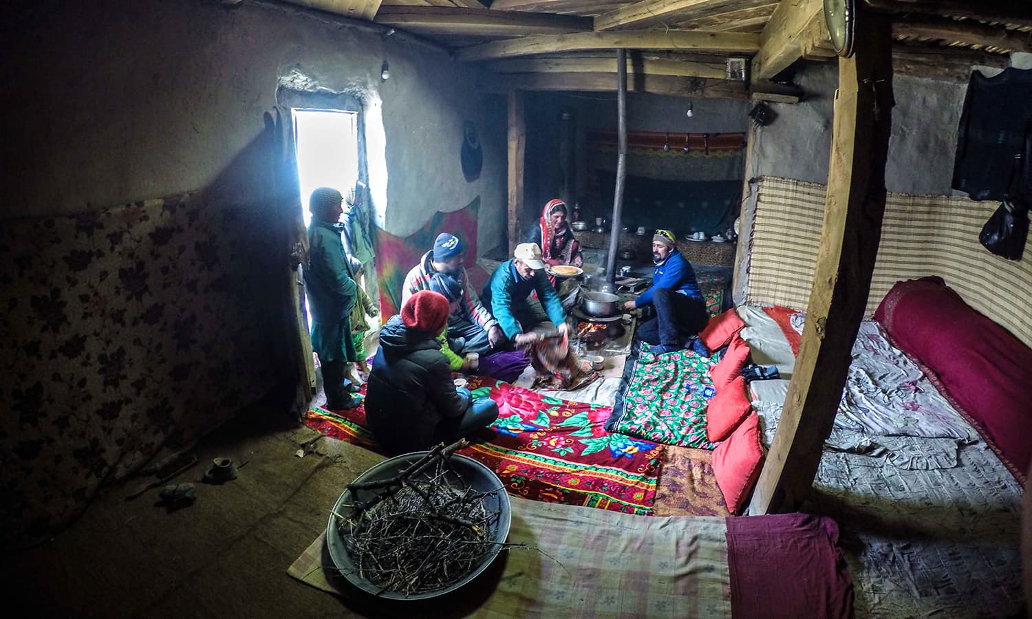 We had chai in a modest, single-room with the same kind of wooden ceiling most homes in Shimshal had. — Photo by author