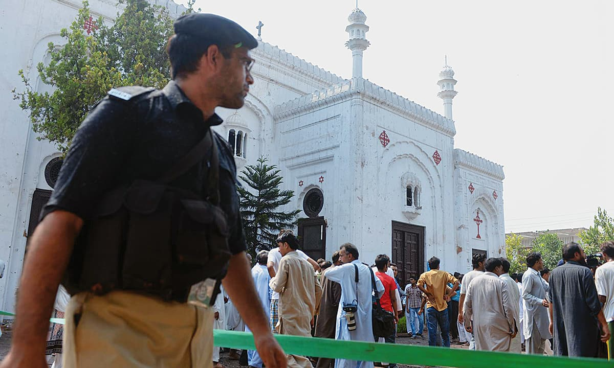 Security personnel and rescue workers gather at  the All Saints Church in Peshawar after a suicide blast | Abdul Majeed Goraya, White Star