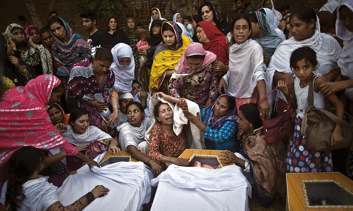 Relatives of the victims of the  All Saints Church blast mourn at the Lady Reading Hospital in Peshawar | Abdul Majeed Goraya, White Star