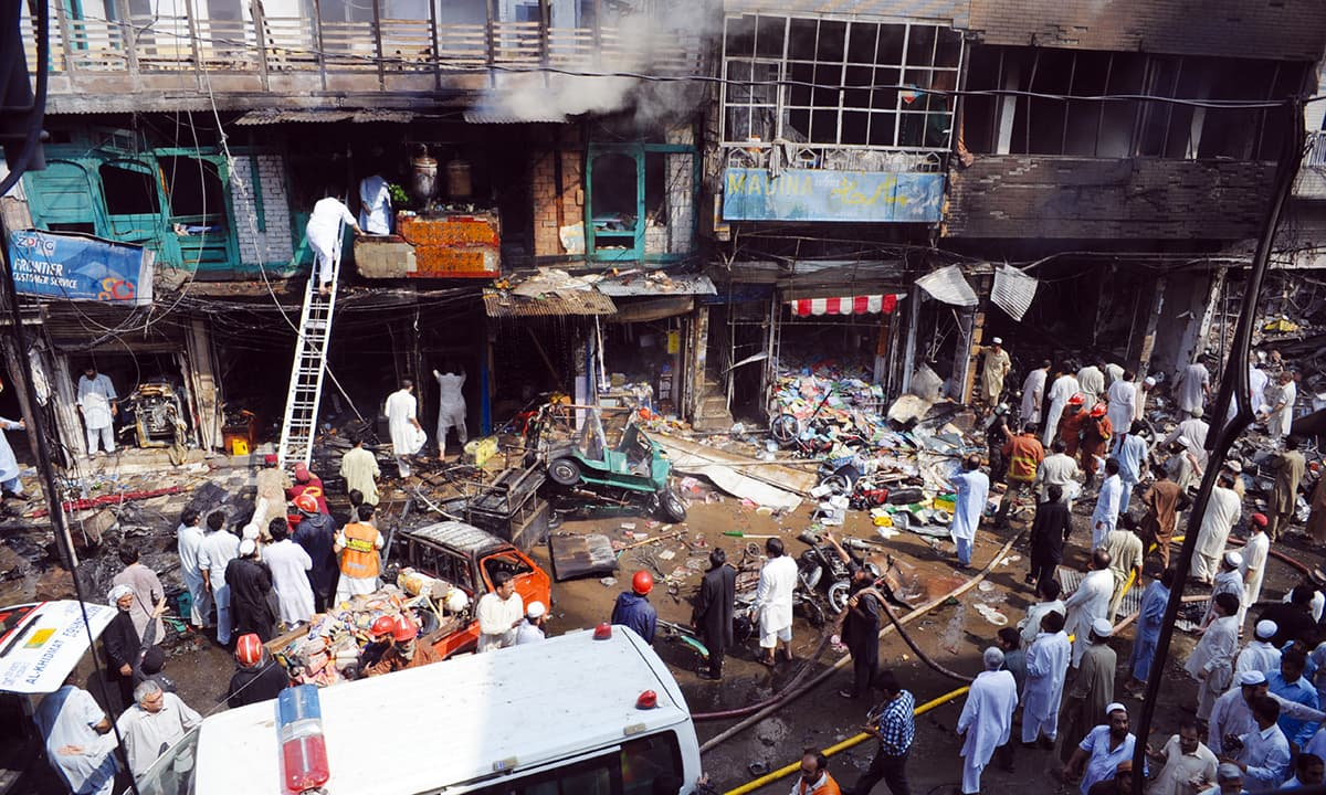 Rescue operation underway at the Qissa Khawani bazaar following a blast in September 2013 | Shahbaz Butt, White Star