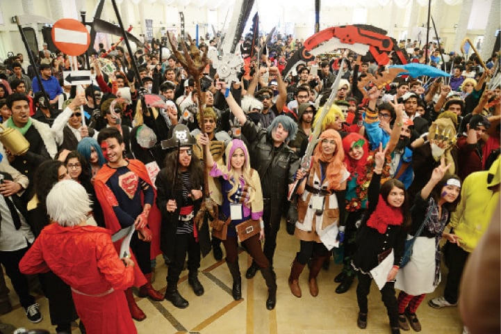 Fans dressed up as their favourite characters gather in the hall during the third TwinCon in Islamabad on Sunday. — Dawn