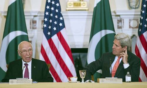 US Secretary of State John Kerry and Foreign Affairs Adviser Sartaj Aziz participate in the US-Pakistan Strategic Dialogue meeting at the State Department in Washington. ─AP