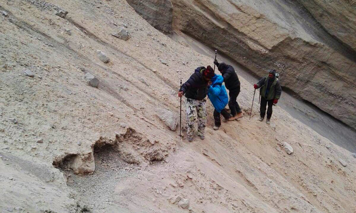 Final leg of the rockfall and I am hanging on to my guides for dear life. — Photo by Mirza Ali Baig