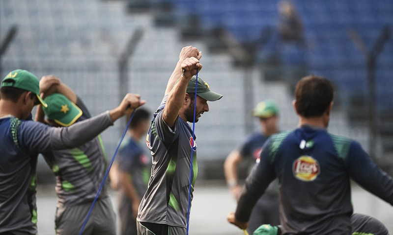 Pakistan captain Shahid Afridi stretches during a training session at the Khan Shaheb Osman Ali Stadium in Fatullah. — AFP/File
