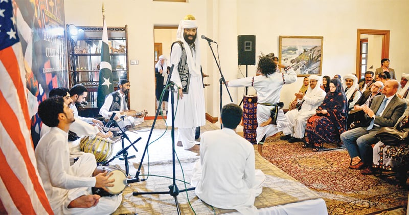 Folk singer Akhtar Chanal Zehri performs at the US consulate on Wednesday.—White Star
