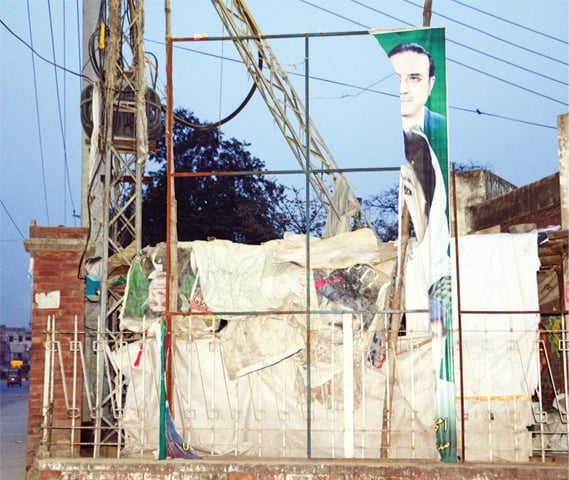 A torn banner at Benazir Bhutto's assassination site in Liaquat Bagh. —  Photo by Khurram Amin