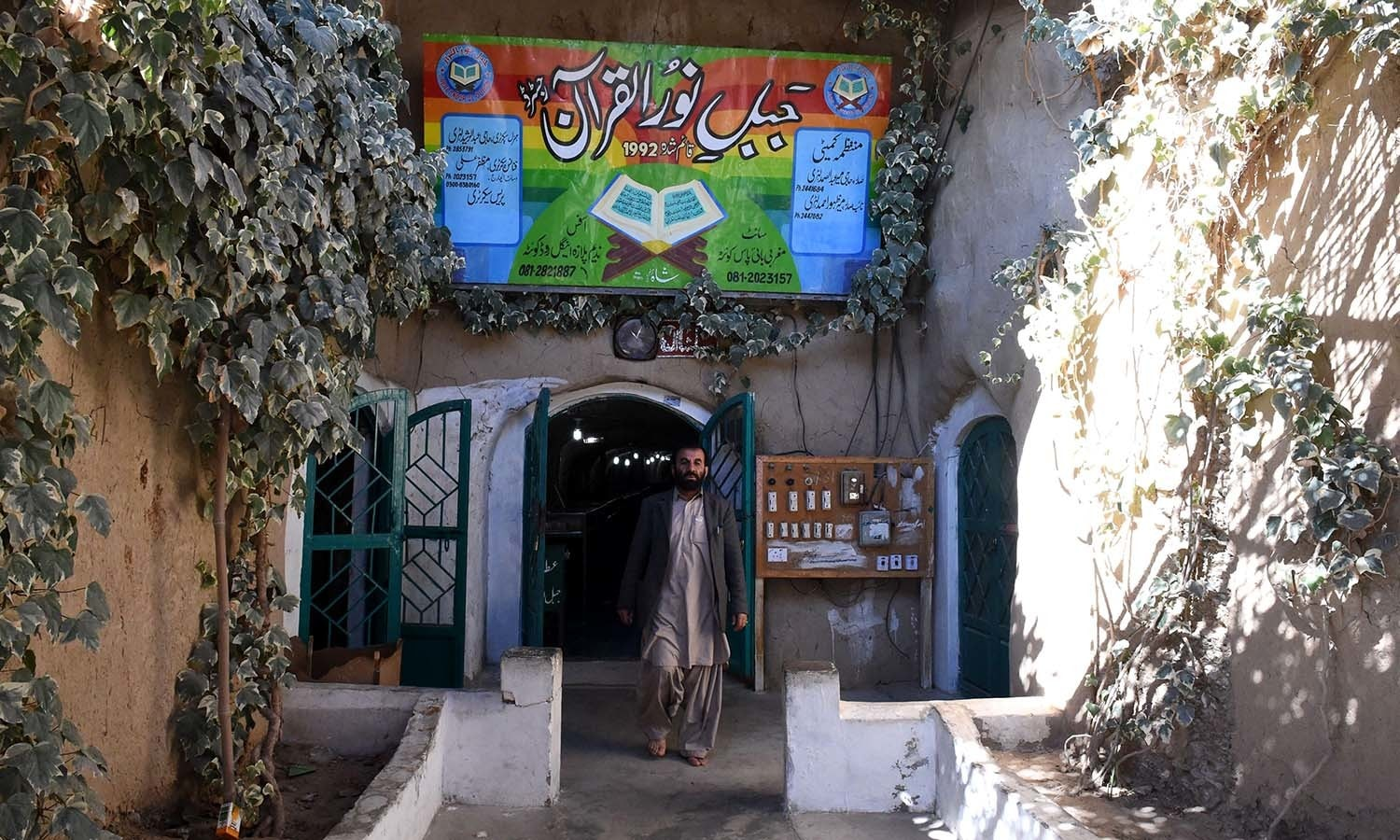 A devotee coming out of a tunnel in Jabl-e-Noor. ─ AFP