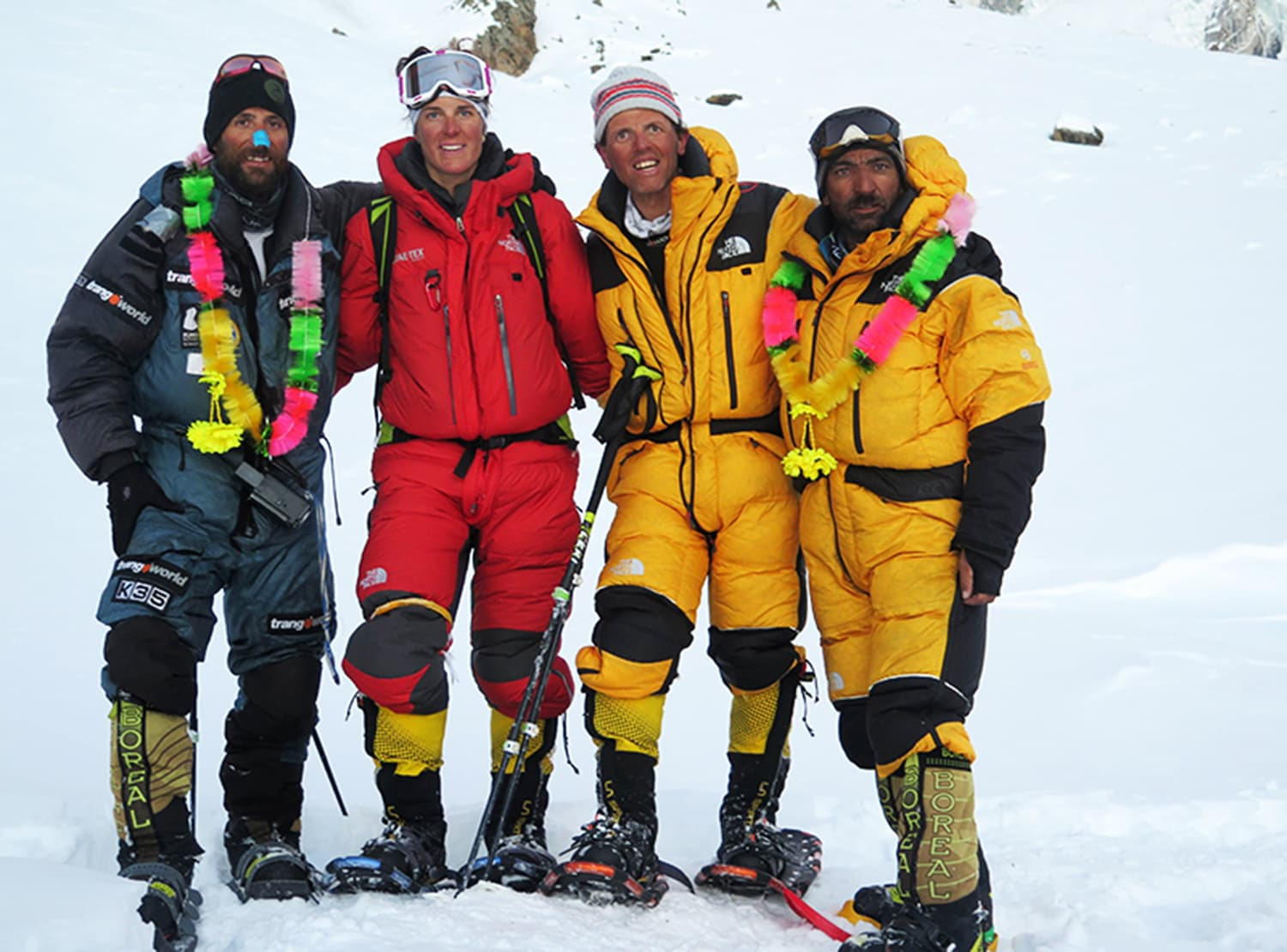 "This photograph taken on February 27, 2016 shows Italian climber Simone Moro (2R), Pakistani climber Ali Sadpara (R) and Spain climber Alex Txikon (L) posing for a photograph after scaling the peak of Nanga Parbat which is known as ""Killer Mountain"" along with an Italian climber Tamara Lunger (2L). —AFP"