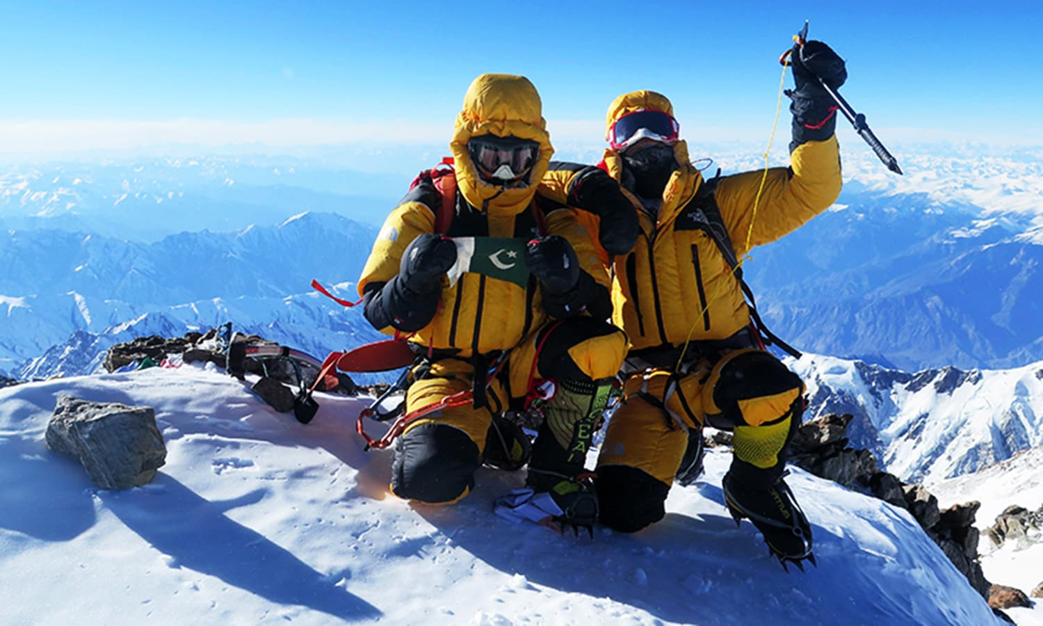 "Italian climber Simone Moro (R) and Pakistani climber Ali Sadpara celebrate after scaling the peak of Nanga Parbat which is known as ""Killer Mountain"" and second highest peak after K2 in this photograph taken on February 26, 2016, released by Marianna Zanatta Sports Marketing Management.—AFP"