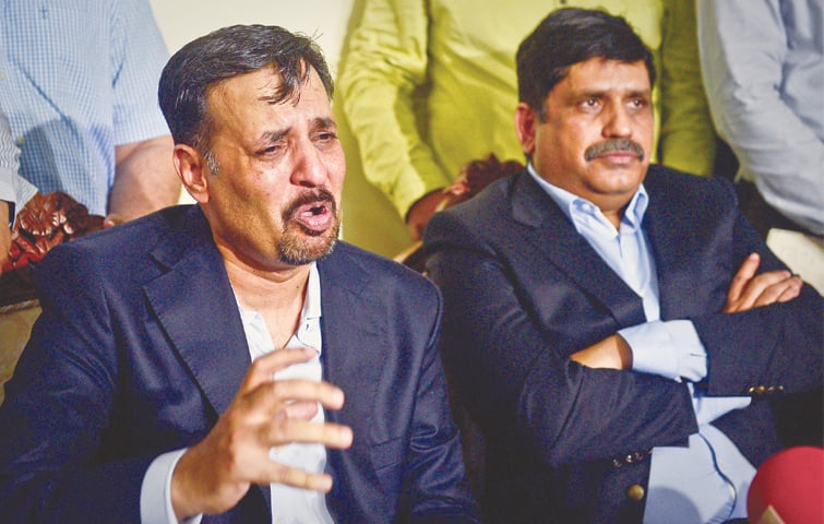 FORMER nazim of Karachi Syed Mustafa Kamal breaks down and weeps while addressing a press conference here on Thursday. Anis Kaim khani is also seen. —Fahim Siddiqi/White Star