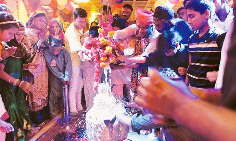 The bathing of Shiva during pooja at the Shree Ratneshwar Mahadev Temple during the Maha Shivratri festival on Sunday.—Mohammad Ali/White Star