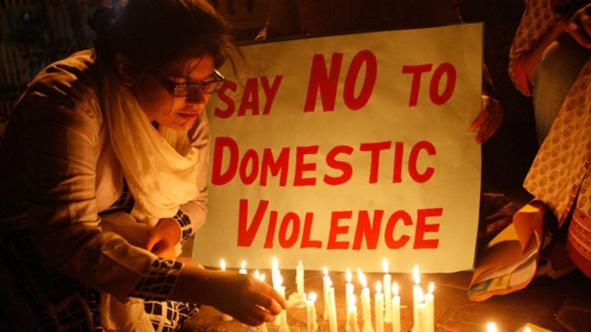 Women light candles for International Women's Day at a rally in Karachi