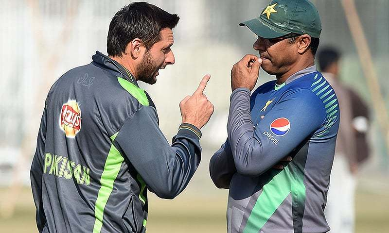 Pakistan T20 captain Shahid Afridi and coach Waqar Younis talk during a training session in Lahore. — AFP/File