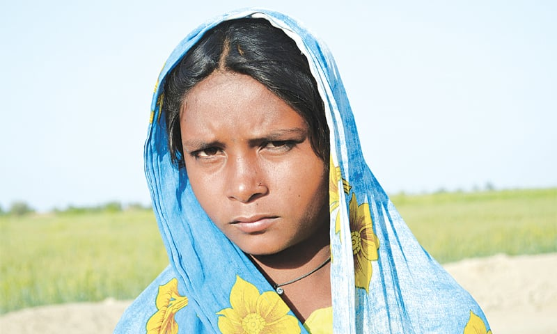 Neelam Kolhi outside her home located near Samaro town in Umerkot district. She was kidnapped and forcibly converted but later a court ordered her return home. The family is impoverished as can be seen by their makeshift hut. -Photos by Amar Guriro