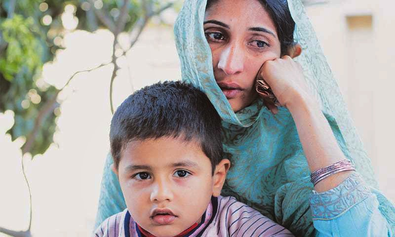 Basra Bibi with her son at the Edhi Home in Lahore. A victim of domestic abuse, her case was the first one filed after the passage of the Punjab Protection of Women against Violence Bill, 2016 from the provincial assembly.—Photo by writer