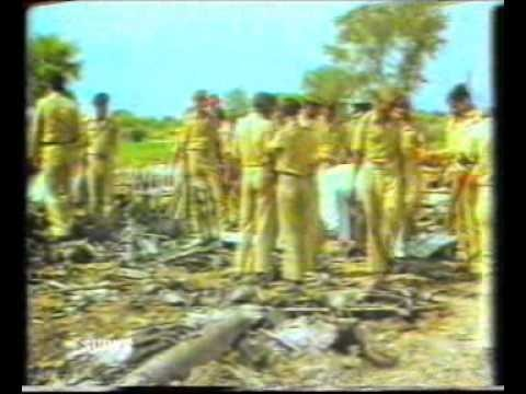 Security personnel investigate the debris of the plane in which Zia was travelling. It allegedly had a bomb planted on it which caused it to crash, killing all the passengers (August 1988).