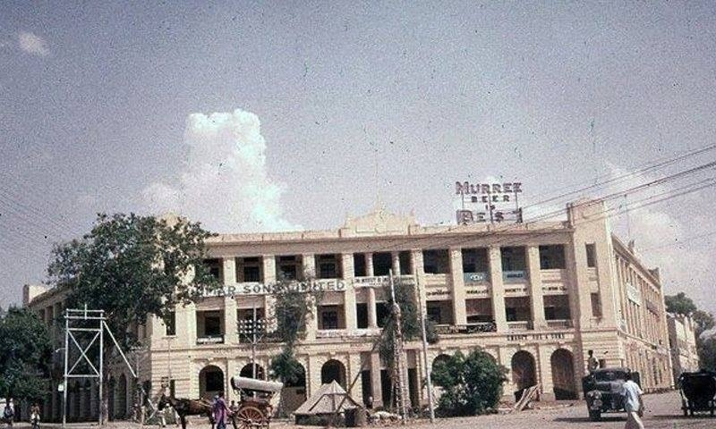A neon sign of the Pakistani beer brand, Murree Beer, stands atop a building at the Mall Road in Lahore (early 1960s).