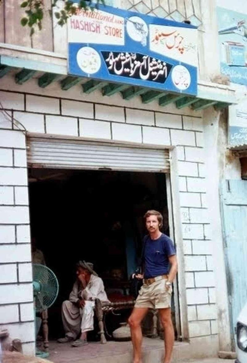 A western tourist posing in front of a 'legal' hashish shop in South Waziristan in 1976.