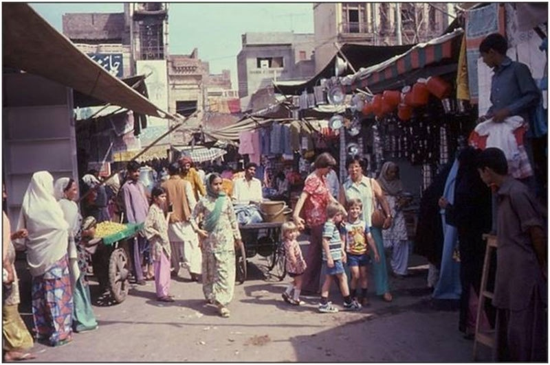 Western tourists in an old bazaar in Lahore (1973).