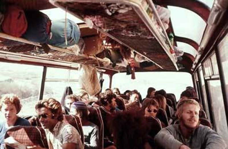 Tourists entering Pakistan from Afghanistan on a bus (1975).