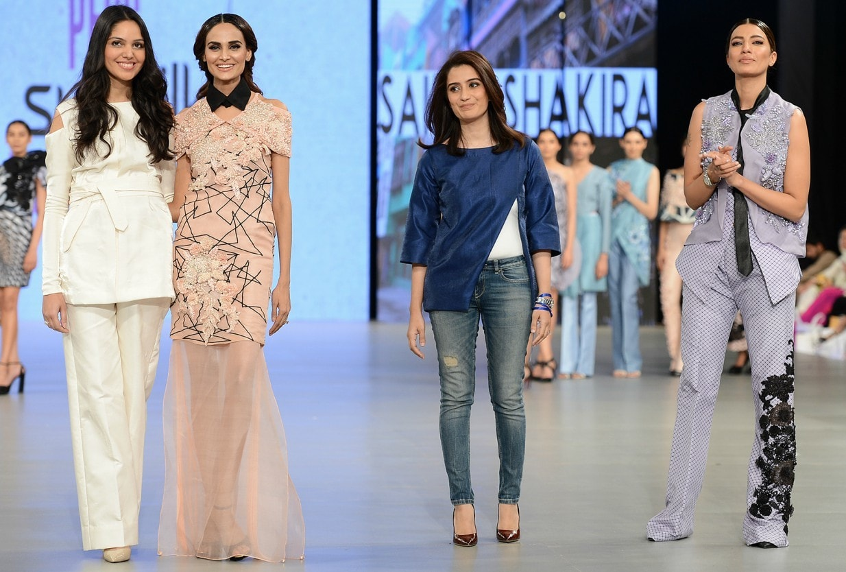 Seen here with the designers, Mehreen Syed (second from left) models a jarring piece from 'Ysatis' while Rabia Butt (far right)is clad in one of the saving graces of the collection