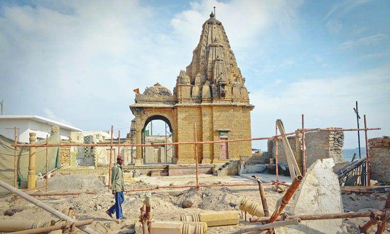 RESTORATION work under way on the Varun Dev temple.—White Star