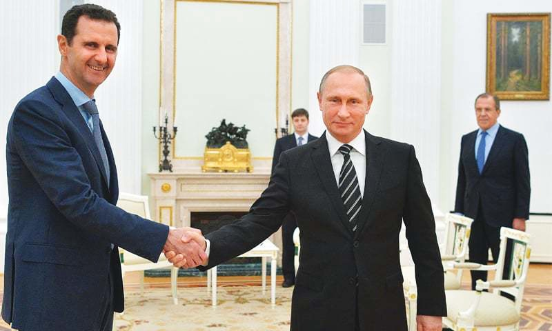 In this file photo taken on Oct 20, 2015 Russian President Vladimir Putin shakes hand with Syrian President Bashar al-Assad in the Kremlin in Moscow.—AP