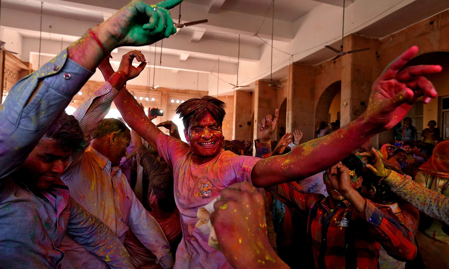 Hindu devotees take part in Holi in Barsana. ─ Reuters