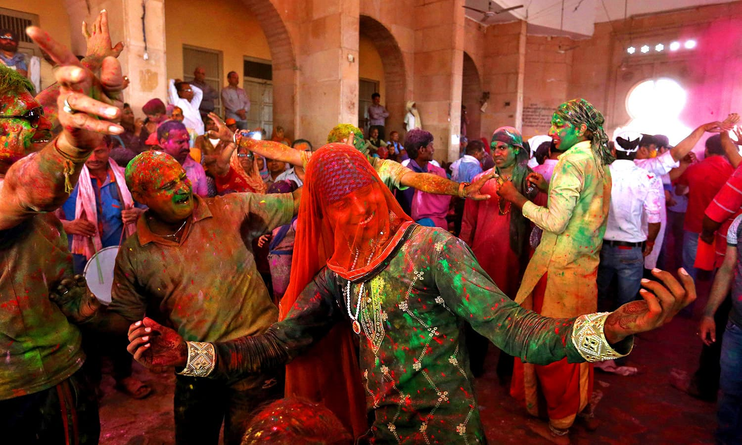 Hindu devotees take part in Holi in Barsana. ─ AFP