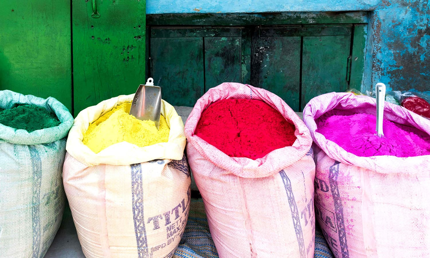 Bags of colourful powder ready to be used for the Holi festival at the Radha Rani temple in Barsana. ─ AFP