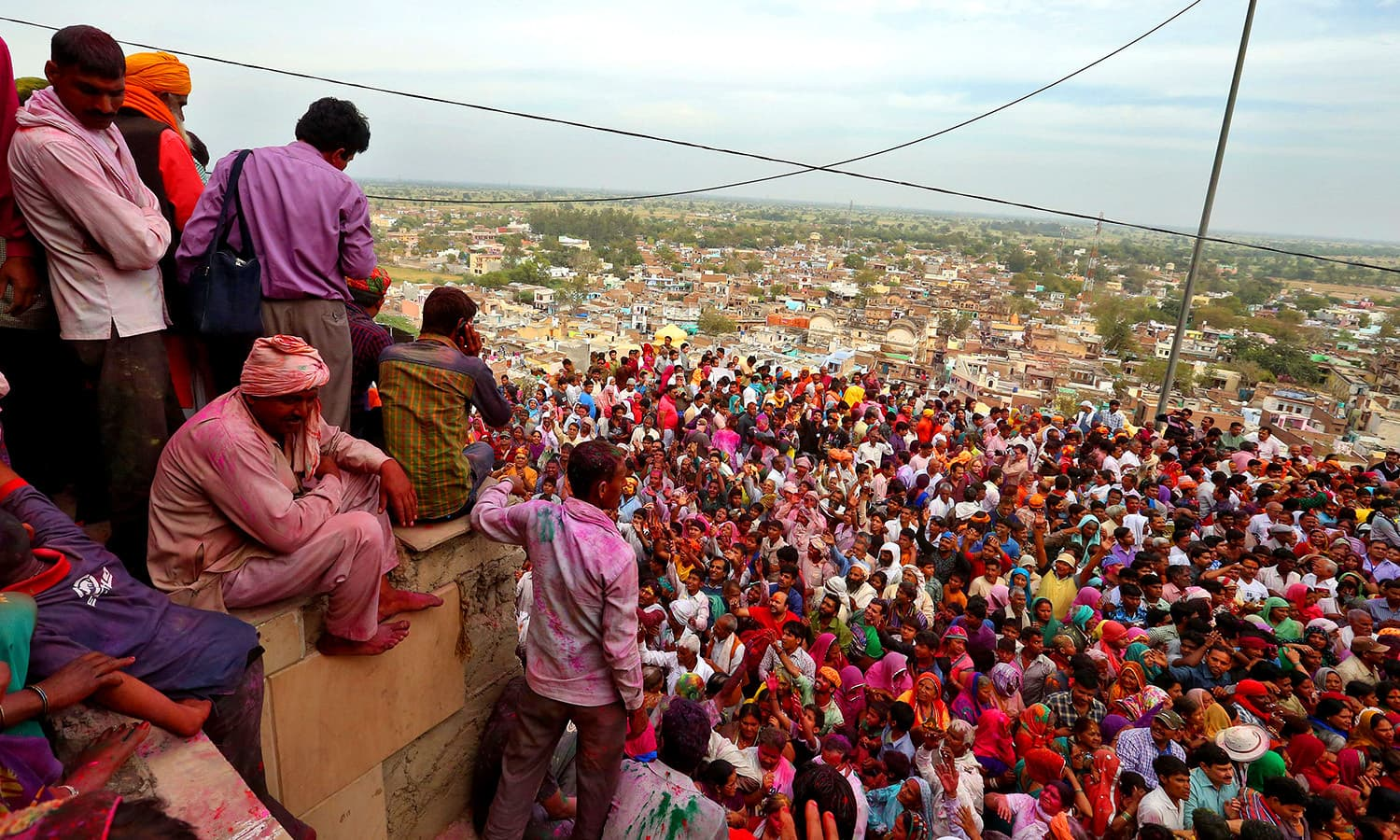 Hindu devotees take part in Holi. ─ Reuters