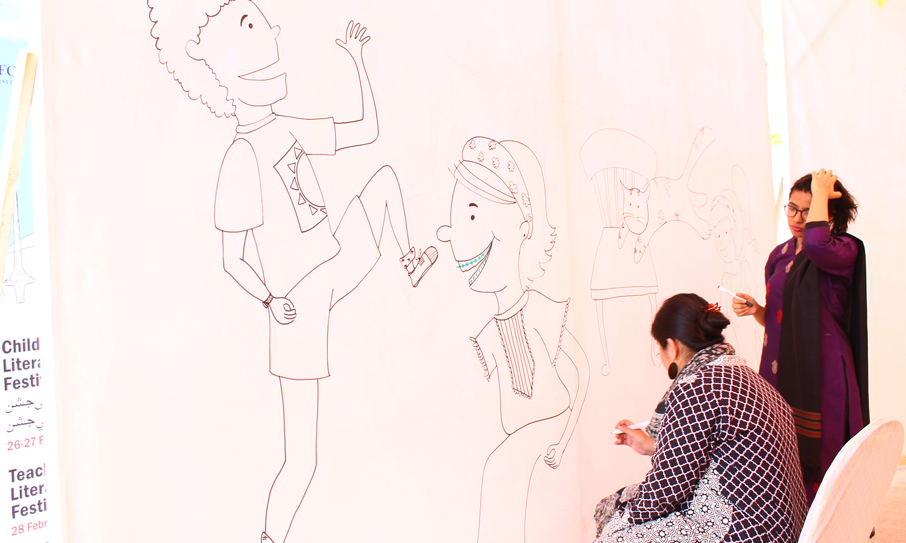 Paintings being made on the walls of the event held at the Dawood Public School, in Karachi
