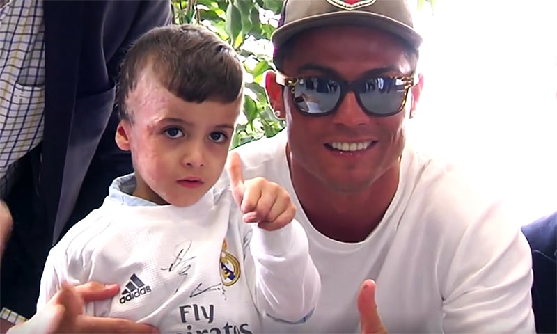 Ahmed Dawabcheh poses for camera with Real Madrid's Cristiano Ronaldo.─ Real Madrid Video screenshot
