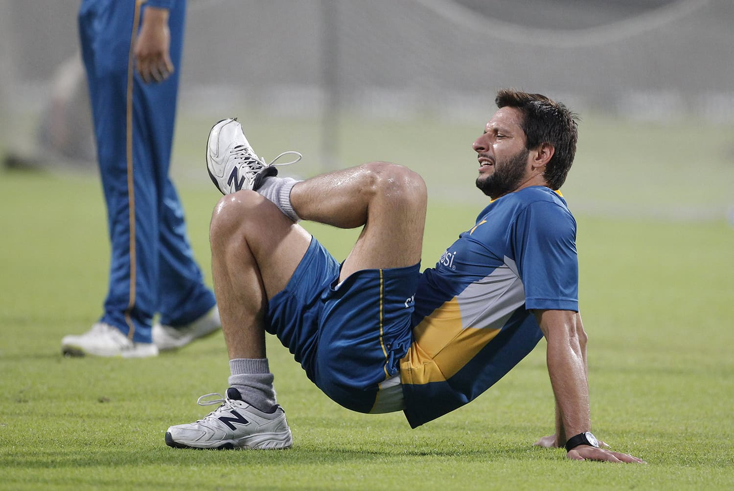 Afridi warms up during a training session ahead of Pakistan's World T20 match against India in Kolkata. — AP