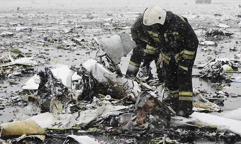 Emergencies Ministry members search the wreckage at the crash site of Flight number FZ981, a Boeing 737-800 operated by Dubai-based budget carrier Flydubai, at the airport of Rostov-On-Don, Russia, March 19, 2016.—Reuters