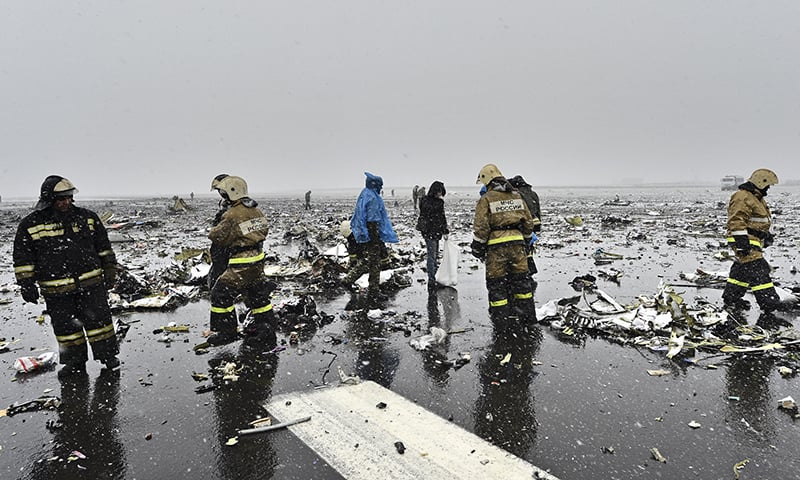 Russian Emergency Ministry employees are seen among the wreckage of a crashed plane at the Rostov-on-Don airport, about 950 kilometers south of Moscow, Russia Saturday, March 19, 2016.—AP