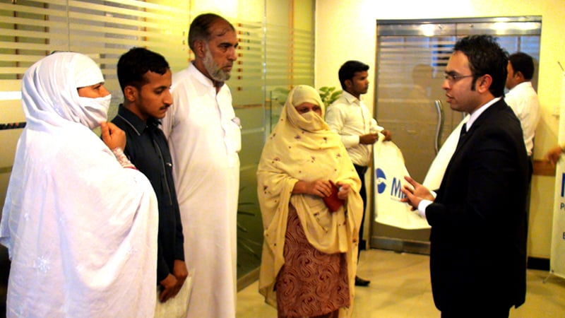 Iqbal's wife meets with MILVIK representatives to receive the Rs300,000 as a successful claim