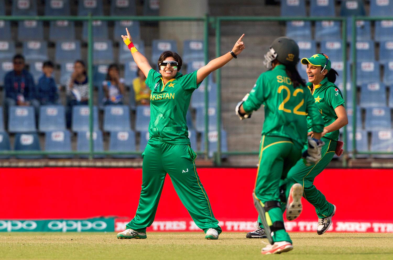 Pakistan's Nida Dar, left,  celebrates the wicket of India's captain Mithali Raj. — AP