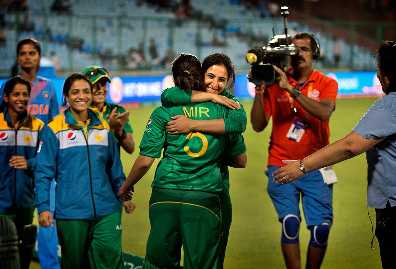 A Pakistani cricket player hugs her captain Sana Mir. — AP
