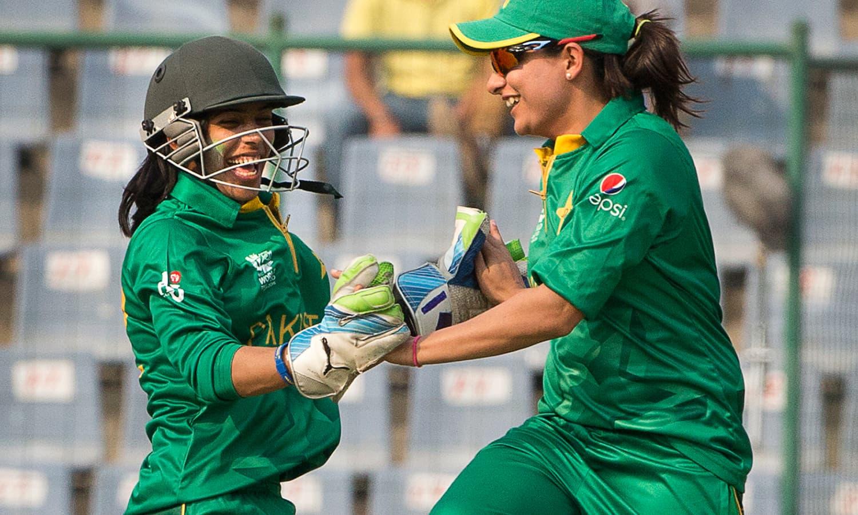 Pakistani captain Sana Mir, right, celebrates the wicket of India's Vellaswamy Vanitha with her wicket keeper Sidra Nawaz. — AP