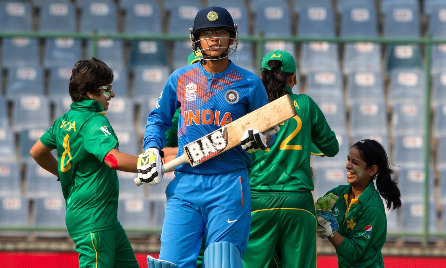 Pakistan players celebrate the wicket of India's Smirti Mandhana. The green shirts were extraordinary with the ball early in the innings. — AP