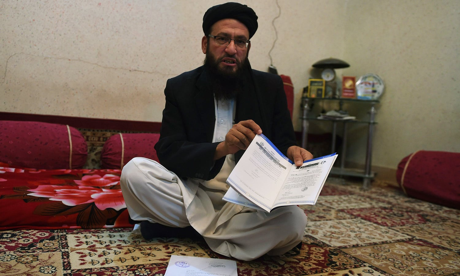 Government appointed Islamic cleric Maulana Umar Sadiq speaks during an interview with AFP in Karachi in this photograph taken on February 16, 2016.—AFP