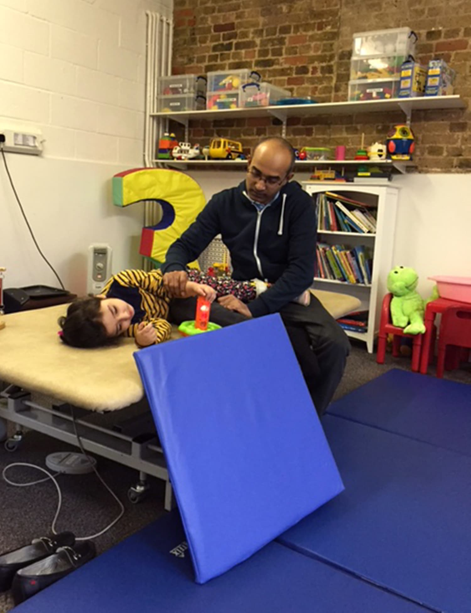 Ameera getting physiotherapy in England at the Bobath Center