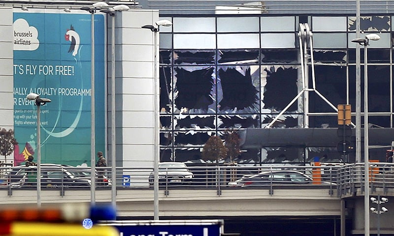 Broken windows seen at the scene of explosions at Zaventem airport near Brussels, Belgium, March 22, 2016.—Reuters