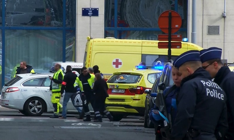 Emergency personnel are seen at the scene of a blast outside a metro station in Brussels, in this still image taken from video on March 22, 2016.—Reuters