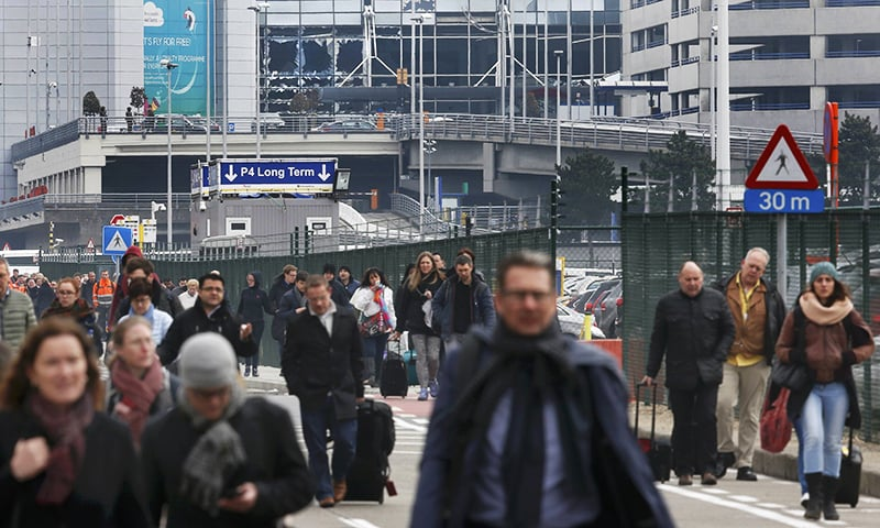 People leave the scene of explosions at Zaventem airport near Brussels, Belgium, March 22, 2016.—Reuters