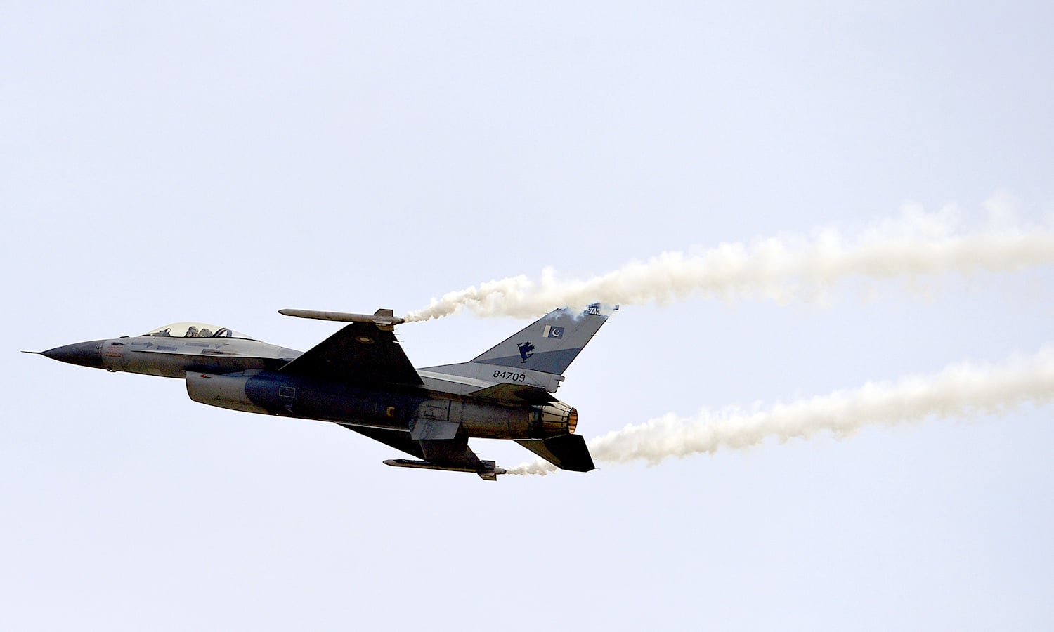 An F-16 fighter performs a flypast during parade. ─ AFP