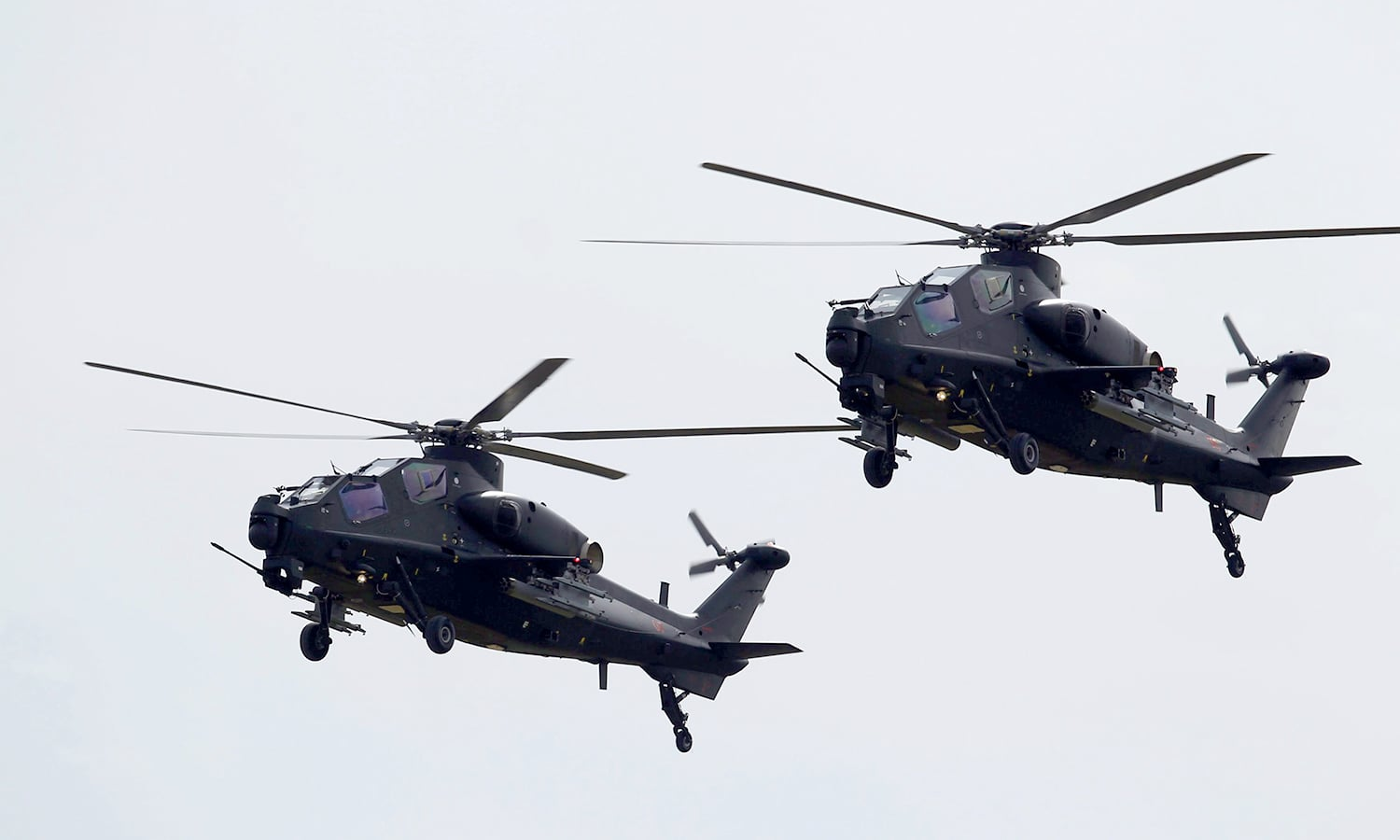Z-10 attack helicopters fly past during the parade. ─ Reuters