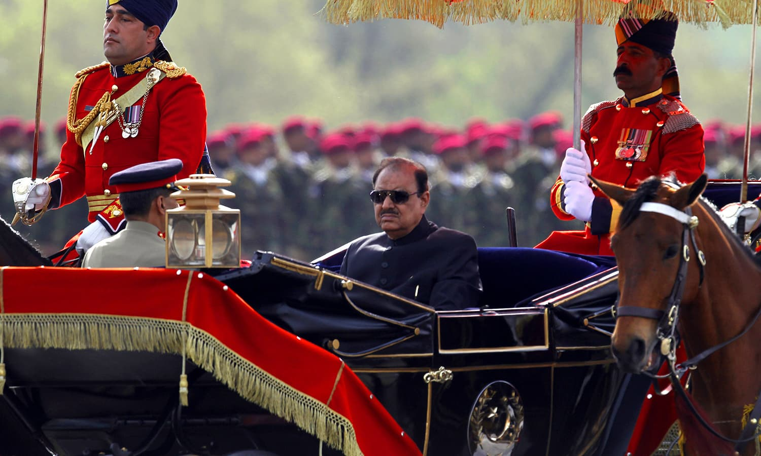 President Mamnoon Hussain arrives to attend the Pakistan Day military parade. ─ AP